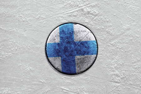 Washer with the image of the Finnish flag on a hockey rink photo
