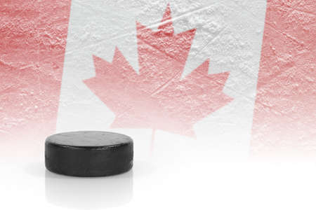 oncept: Hockey puck and a Canadian flag image. ?oncept
