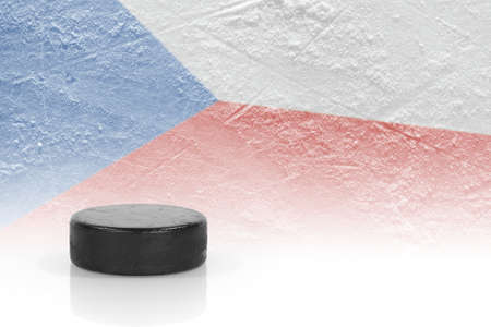 Hockey puck and the image of the Czech flag. Concept photo