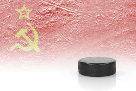 soviet flag: Hockey puck and the image of the Soviet flag. Concept