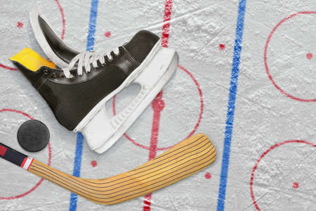 Hockey skates, stick and puck on a hockey rink. Concept