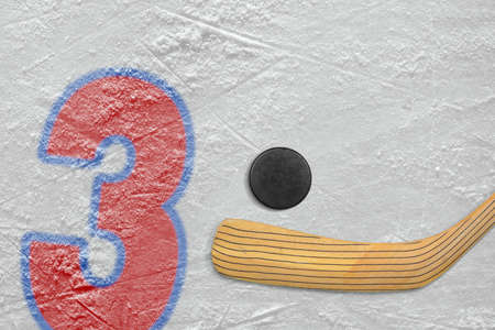 numeral: Hockey stick, puck and the numeral three painted on the ice