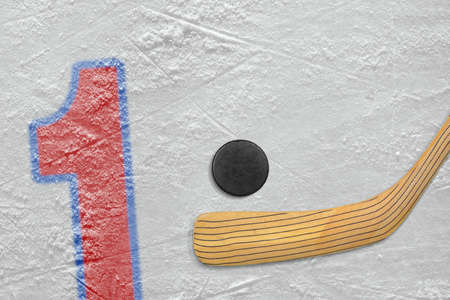 numeral: Hockey stick, puck and the numeral one painted on the ice Stock Photo