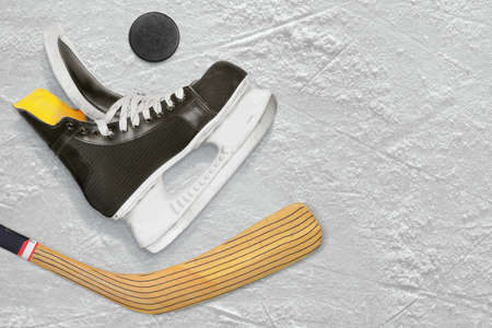 ice arena: Hockey skates, stick and puck on the ice. Texture, background