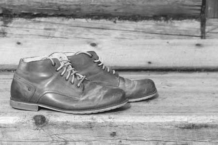 A pair of old mens leather shoes in the exterior