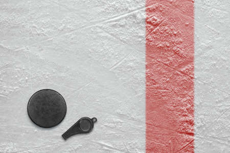 hockey: Referee whistle and washer on the hockey rink. Texture, background