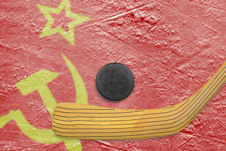 soviet flag: Hockey puck, hockey stick and the image of the Soviet flag on the ice