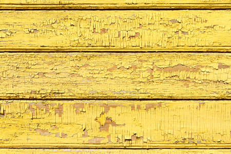 A fragment of an old wooden wall of a house. Texture, background photo