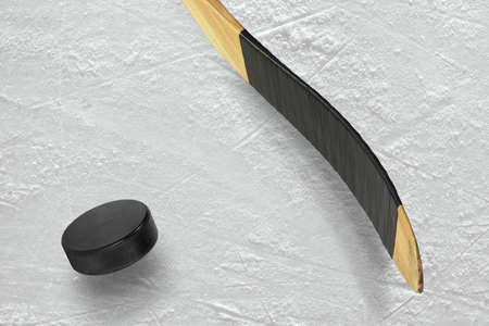 Hockey puck and stick on the ice arena. Texture, background Zdjęcie Seryjne