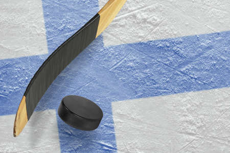ice arena: Hockey puck, stick and a fragment of an image of the Finnish flag Stock Photo