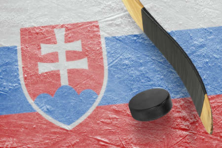 Hockey puck, stick and a fragment of an image of the Slovak flag