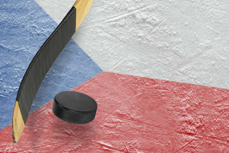 Hockey puck, stick and a fragment of an image of the Czech flag