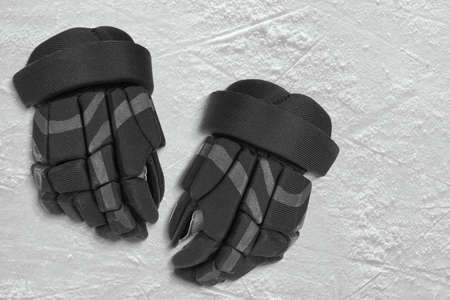 ice arena: Hockey gloves on the ice arena. Texture, background