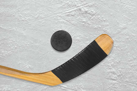 ice arena: Hockey puck and stick on the ice arena. Texture, background Stock Photo