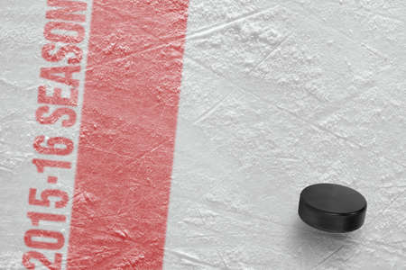 ice arena: Hockey puck on the ice arena. Concept