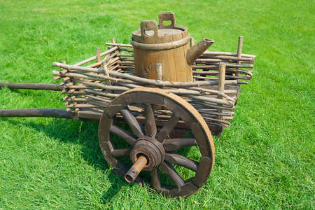 vessel sink: Rustic wagon with old wooden barrel, as an element of landscape design