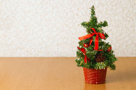 festively: Festively decorated Christmas tree standing on the table