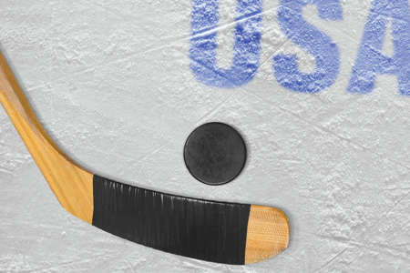 ice arena: American stick and puck on the ice arena. Concept