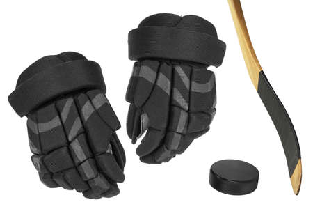 Hockey gloves, stick and puck on a white background