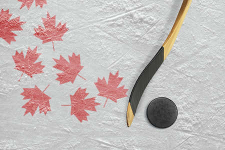 ice arena: Hockey puck, stick, and a schematic representation of the Canadian flag. Concept Stock Photo