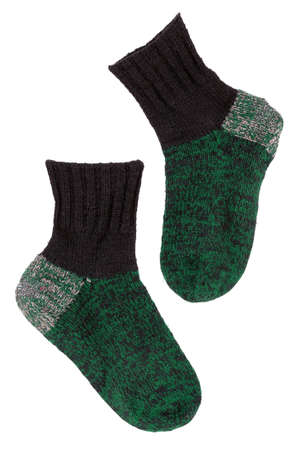 Old green knitted wool socks on a white background Stock Photo