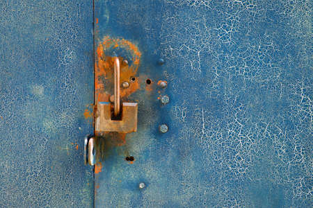 iron curtains: Fragment of a metal door with a lock. Texture, background