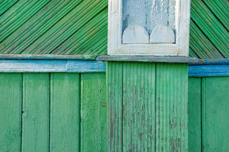 wall decor: A fragment of an old wooden wall decor. Texture, background