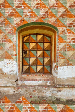 A fragment of the old wall of the house with a window. Texture, background, architecture
