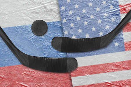 Hockey puck, hockey sticks and the American image, and the Russian flag on the ice. Concept
