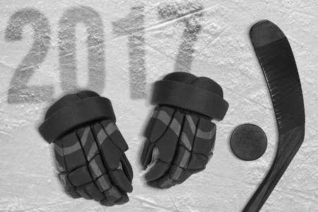 Hockey stick, gloves and puck on ice. Concept, hockey, season