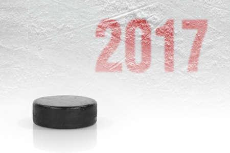 Season 2017 and hockey puck on ice. Concept