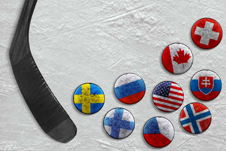 A stick and a hockey puck with images of national flags. Hockey, concept