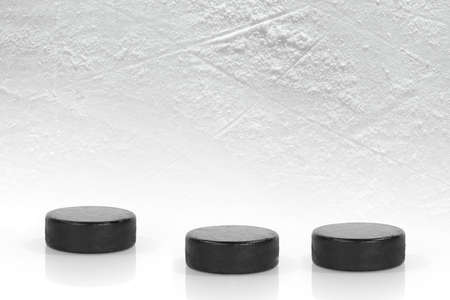 Washers on the ice of the hockey field. Texture, background, concept