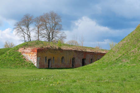 A fragment of fortifications of the old fortress with embrasures. Architecture, fortification, exterior