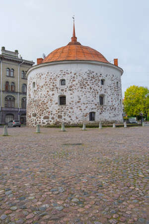 Medieval round fortress tower in the city of Vyborg. Architecture, history, exterior