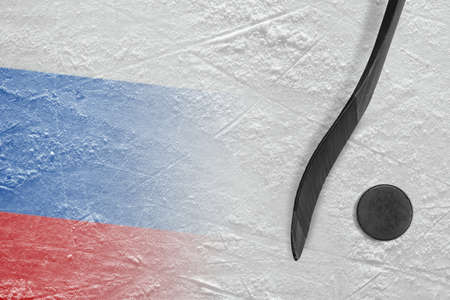 Hockey puck, stick and the image of the Russian flag on the ice. Concept, hockey
