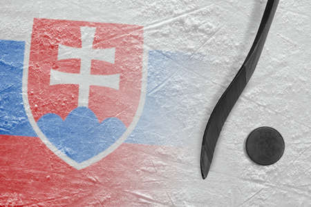 Hockey puck, stick and the image of the Slovak flag on the ice. Concept, hockey
