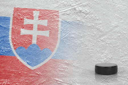 An image of the Slovak flag and on ice and a hockey puck. Concept, hockey