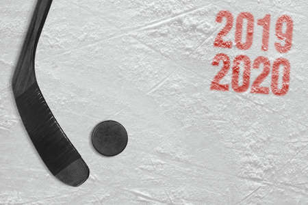 Fragment of a conceptual sports background, hockey sticks and puck. Concept