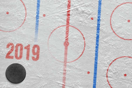 Fragment of a conceptual sports ice background and hockey accessory Stock Photo