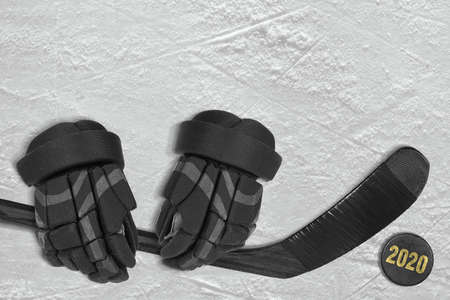 Fragment of a conceptual sports background, gloves, club and puck. Concept
