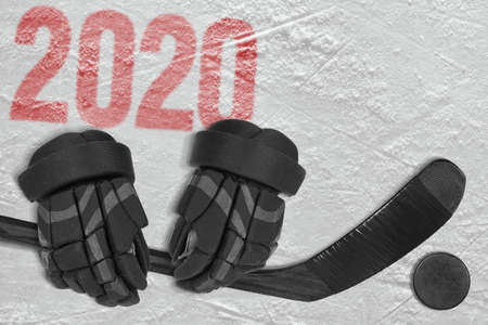 Fragment of a conceptual sports background, gloves, hockey stick and puck. Concept