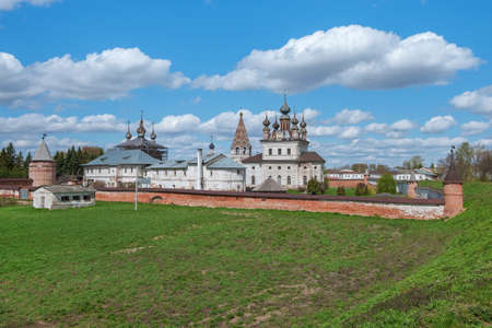 A fragment of the monastery wall and the Orthodox church in the city of Yuryev-Polsky