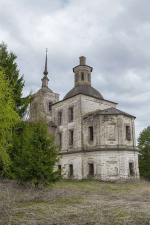 Ancient dilapidated stone cathedral in the forest in the Russian north