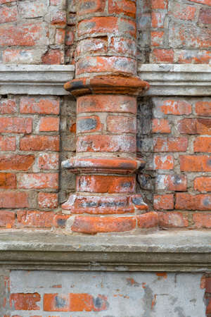 Brick fragment of the wall of the monastery building. Architecture, exterior, background