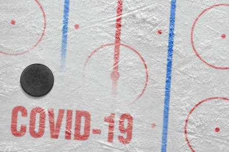 Fragment of a conceptual sports ice background and hockey accessory Stock fotó