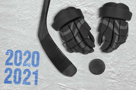 A fragment of a hockey rink, gloves, hockey stick and puck. Concept, hockey season Фото со стока