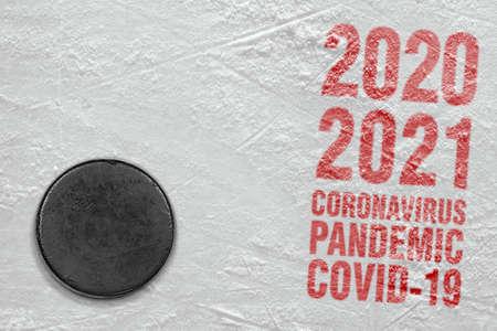 Concept, hockey season, coronavirus. Hockey accessories on the ice arena
