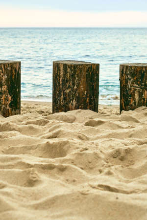 Fragment of a wooden breakwater on the Baltic Sea coast Stock Photo