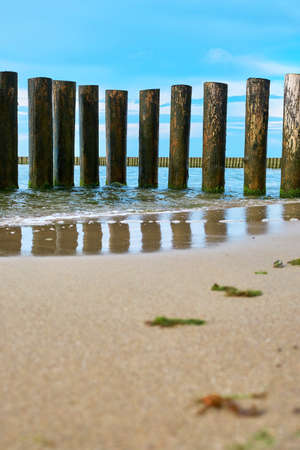 View of a wooden breakwater on the Baltic Sea coast Stock Photo